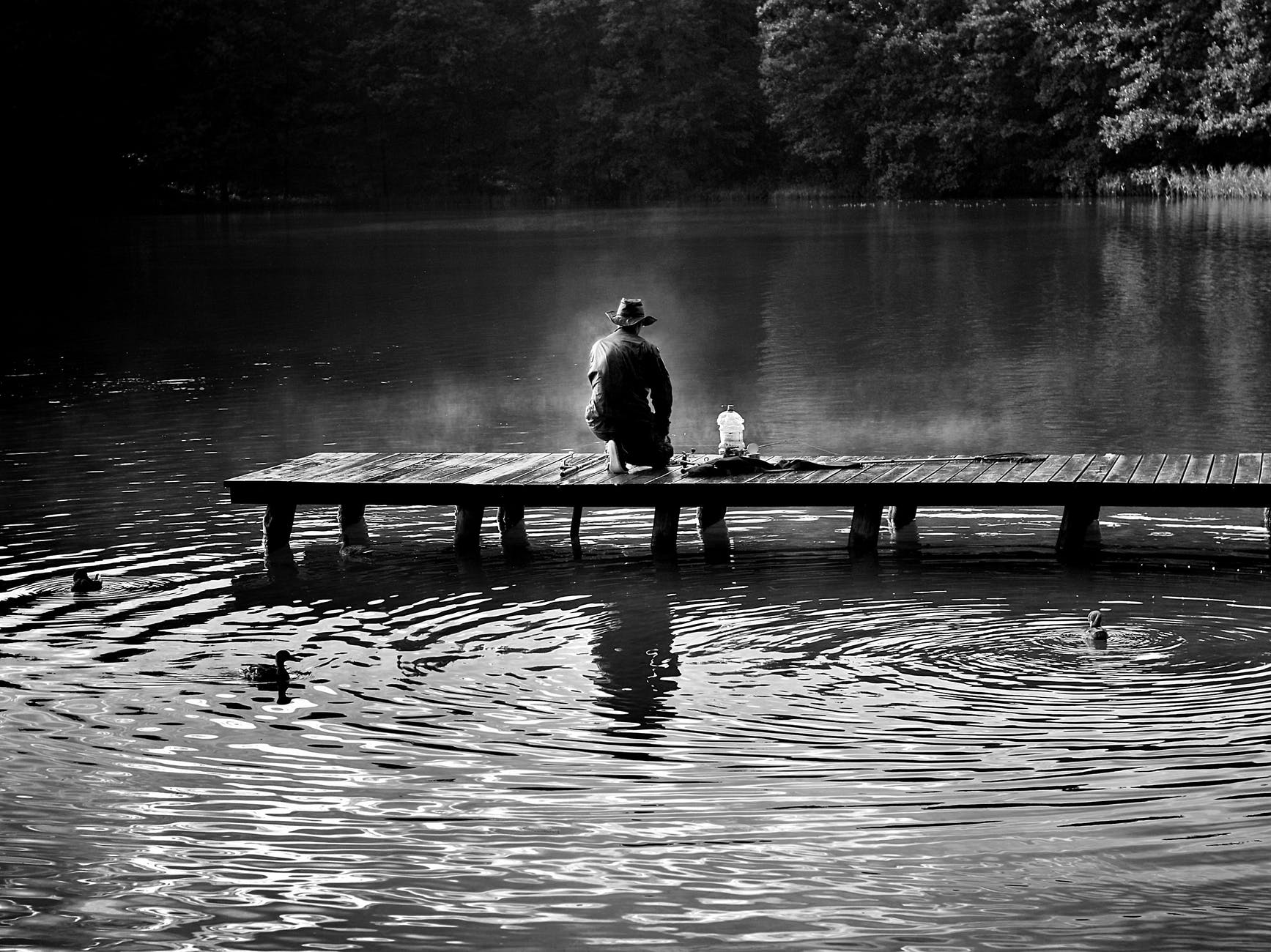 black and white dawn fish fisherman