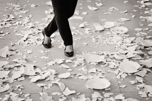 grayscale of woman in black flat sandals walking